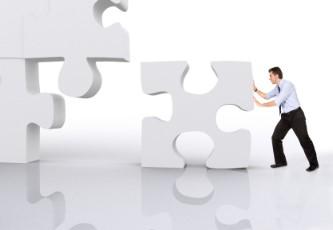 business man building a 3d puzzle over white